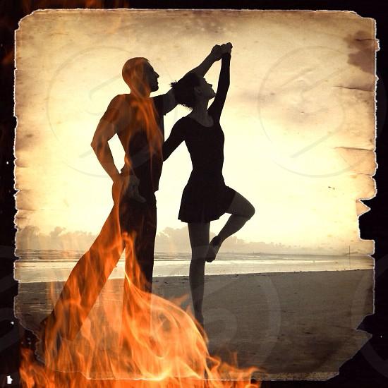Dance sunrise silhouette morning beach Florida abstract fire couple  photo