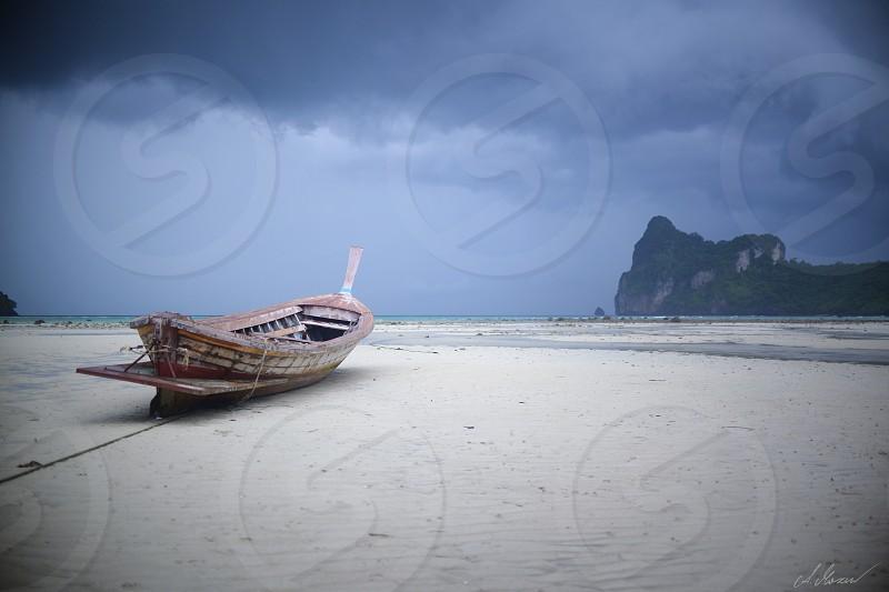 boat beach storm calm sea Thailand photo