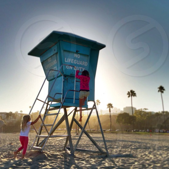 girls climbing lifeguard tower photo