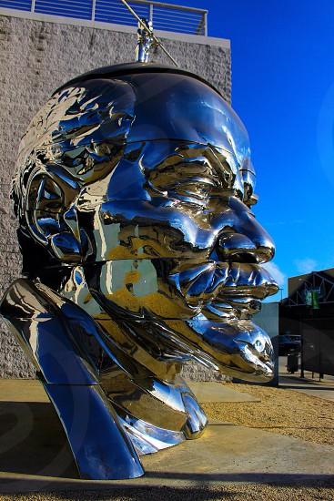 La Los Angeles California art statue street city portrait outdoors outside color shiny face head metal SoCal downtown sunshine sunny bright blue sky photo