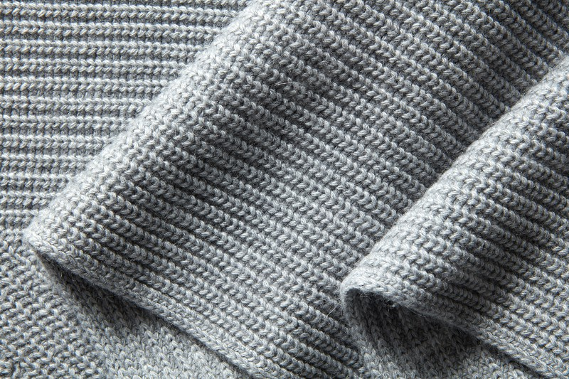 Background of the knitted fabric in the fold photo