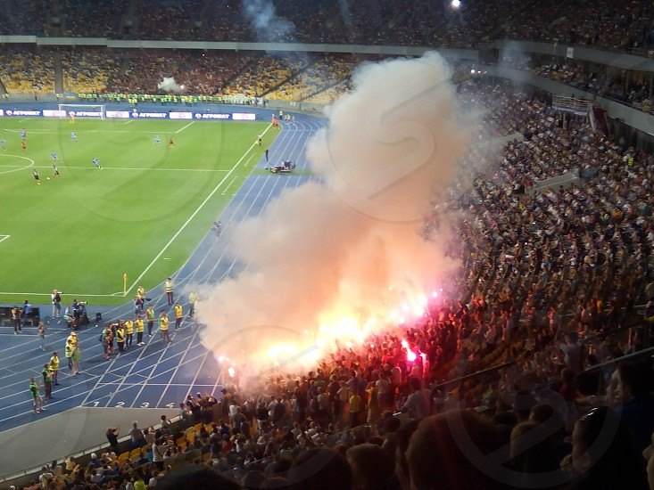 explosion inside soccer stadium court side bench photo