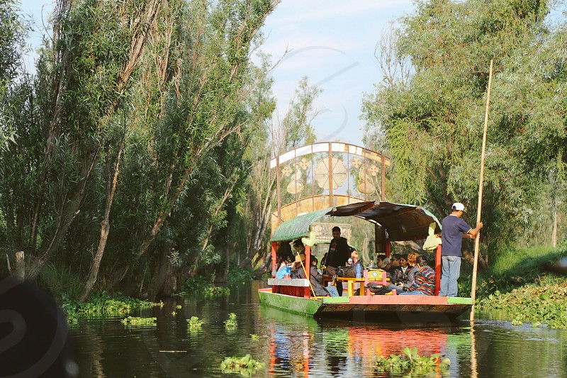 Xochimilco chinampa canal Mexico City Mexico people tradition transportation boat  photo