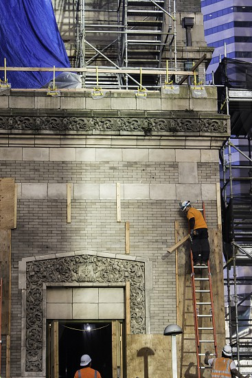 Downtown construction high rise building renovation Seattle tower project bricks ladder worker restoration  photo