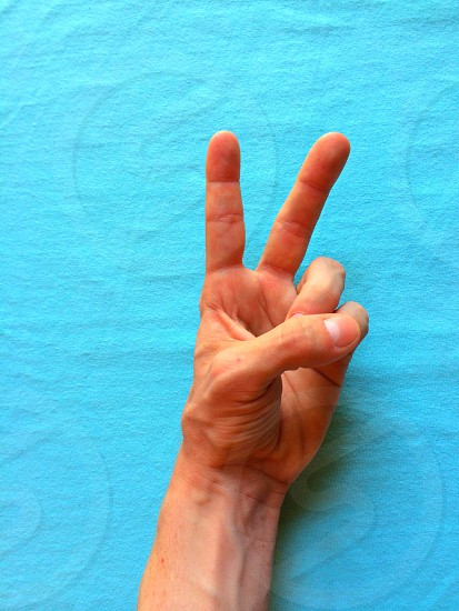 peace hand sign photo