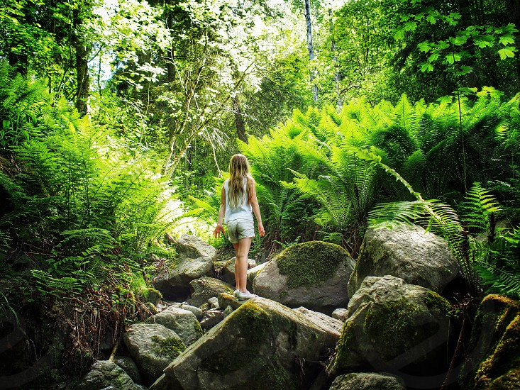In the djungle daughter girl child green stone photo