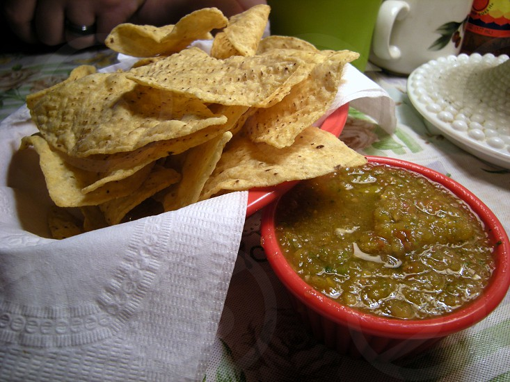 Tortilla chips and green tomatillo salsa photo