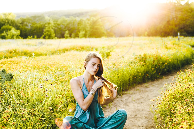 Magic hour portraits of girl in a meadow. photo