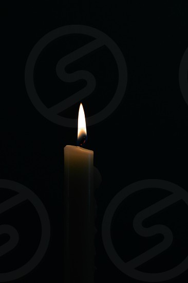 lighted white candle stick photo