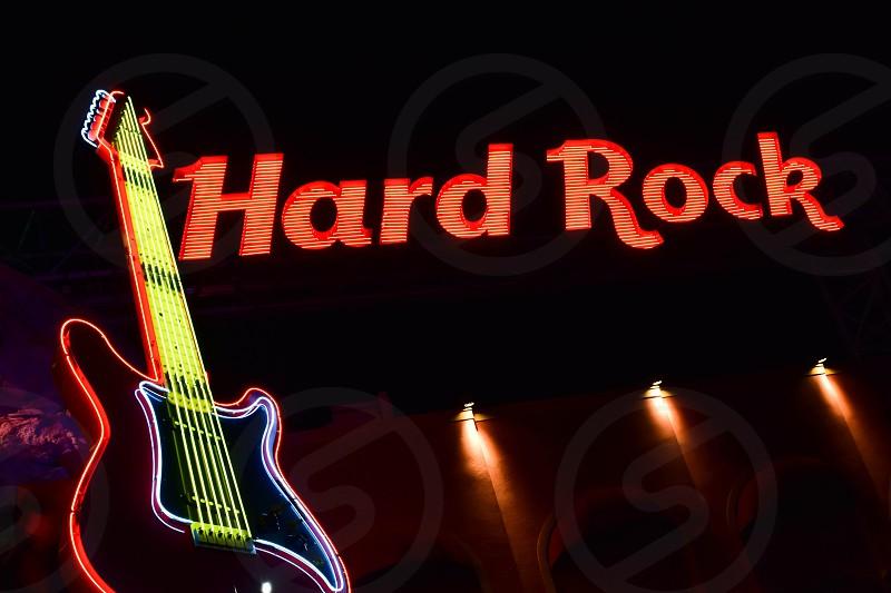 Orlando Florida. February 05 2019.  Hard Rock illuminated sign and colorful guitar in Citywalk at Universal Studios area . photo