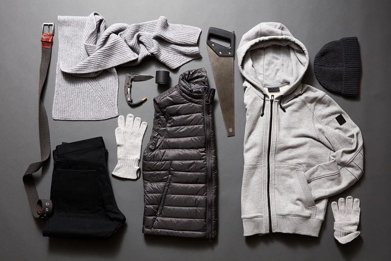 Set men's clothing and accessories with saw on a dark background photo