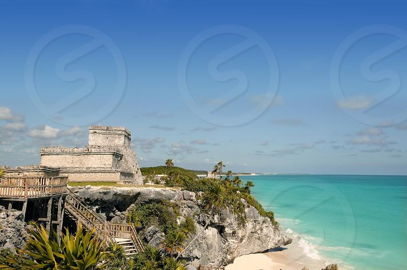 Blue turquoise Caribbean sea over mayan ruins Tulum Mexico photo