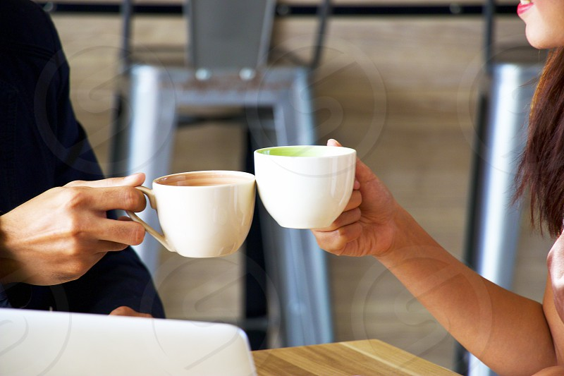 Business people are having coffee break during casual meeting photo