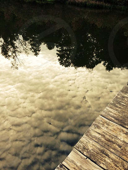view of lake reflecting clouds photo