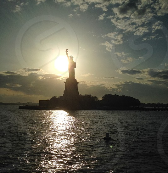 statue of liberty at distance photo