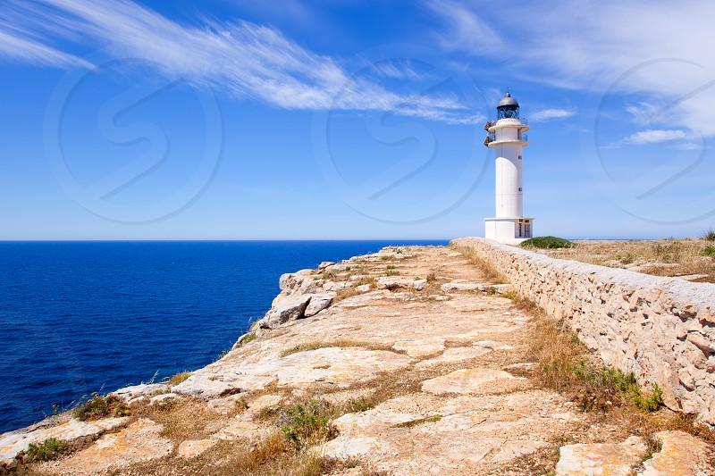 Barbaria Cape lighthouse in Formentera island on Mediterranean Balearic sea photo