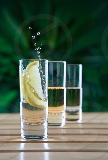 Tequila splash with three glasses: Anejo Resposado and Blanco photo