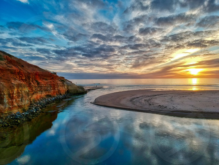 Drone sunset image of the Onkaparinga River mouth sandbar and cliffs.  photo