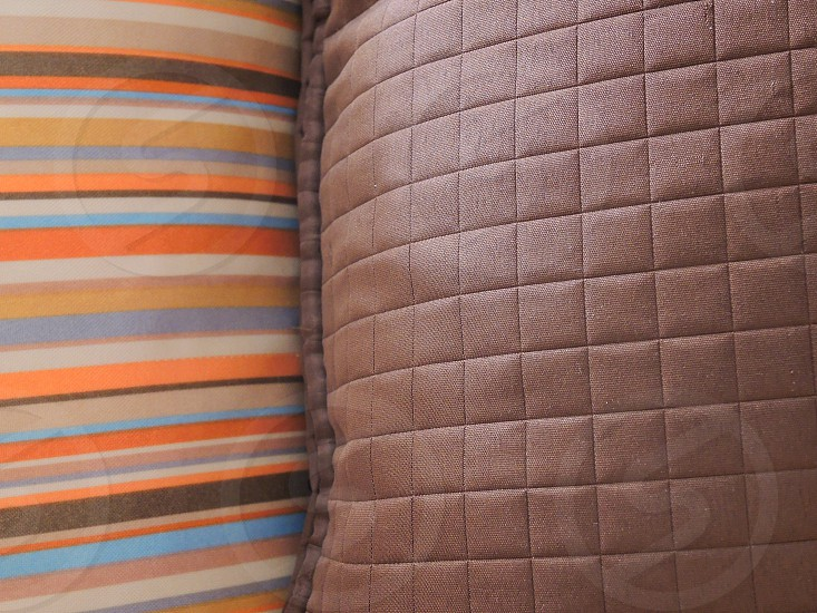 brown quilted textile photo