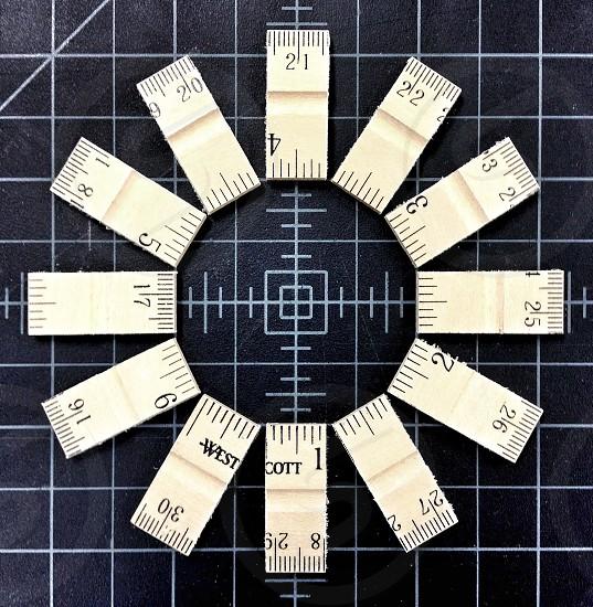 white wooden sliced ruler photo