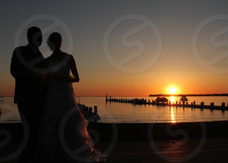 Couple together at sunset wedding photo
