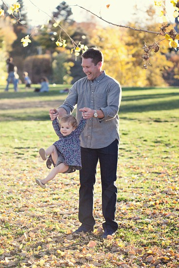 man carrying girl by the hands photo