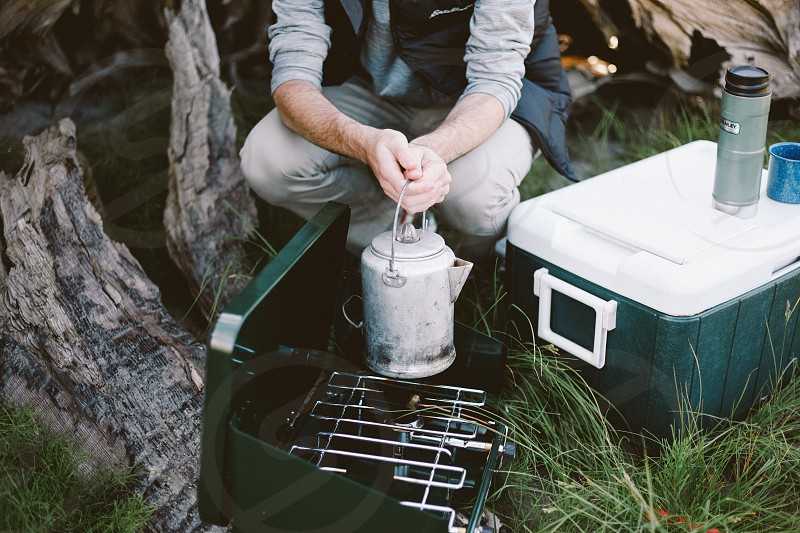 coffee stove grass ice chest photo