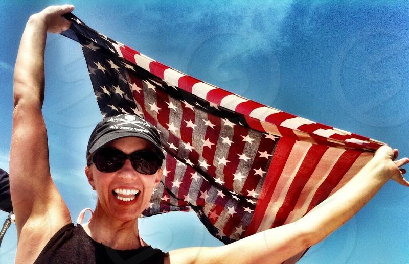 woman holding united states of america flag photo