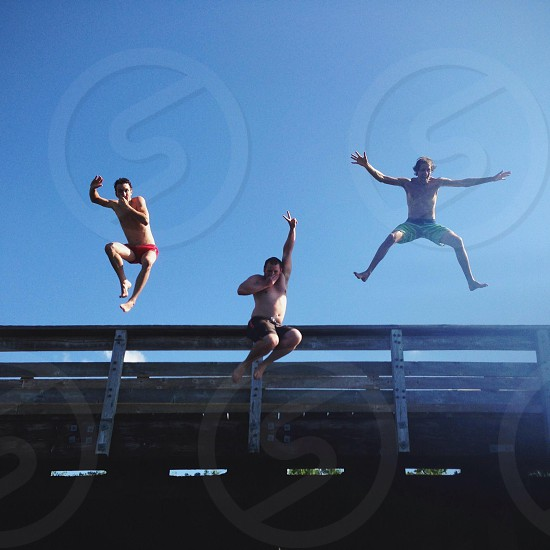 3 person jumping photo