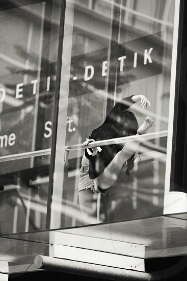 Girl dancing in the window photo