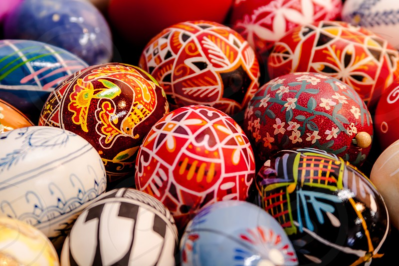 Elaborate hand painted Easter eggs sitting in a basket photo