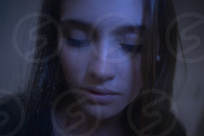 Photo By Sash Alexander Close Up Of A Beautiful Young Woman Behind A Rain Swept Window Feeling And Looking Sad And Upset