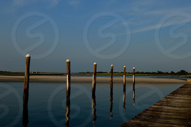brown dock and sea nature photography photo