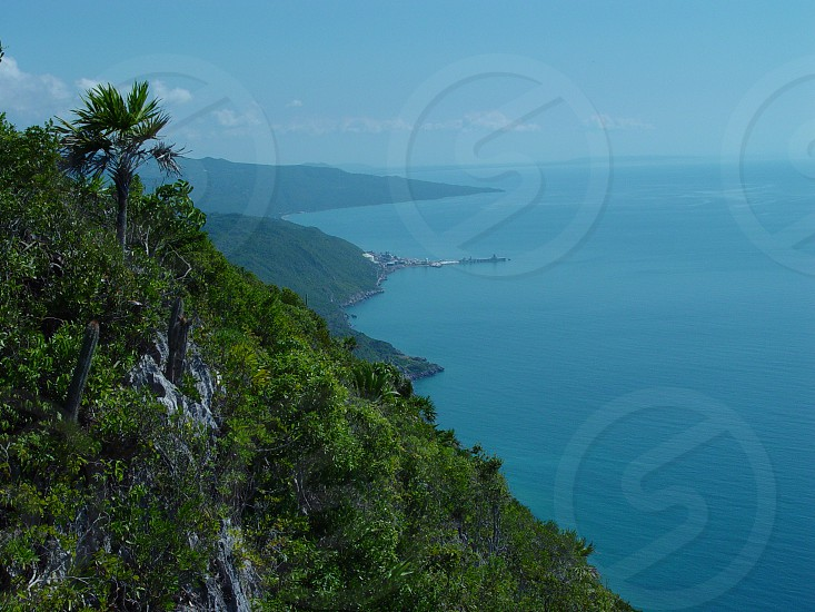 Beautiful Cliff's edged melting into calm blue sea. photo