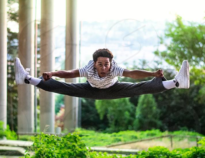 Dancer doing jump splits photo