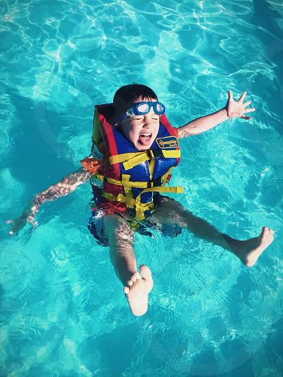 childrens blue yellow and red life vest photo