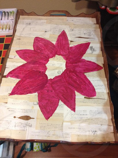 An art piece I'm working on its early stages.  Wooden breakfast in bed tray pages from textbooks in Japanese Elmer's glue magenta acrylic paint photo