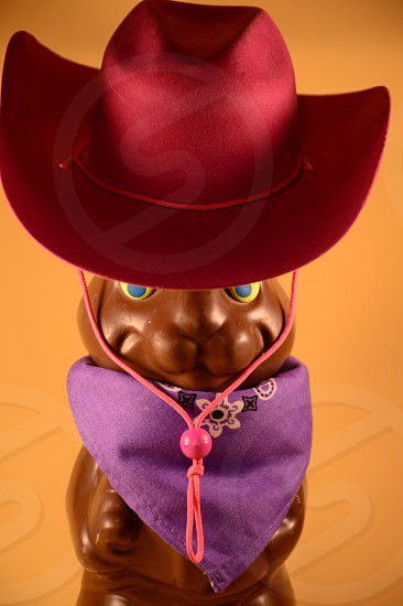 Chocolate Easter bunny in disguise with cowboy hat and bandana photo