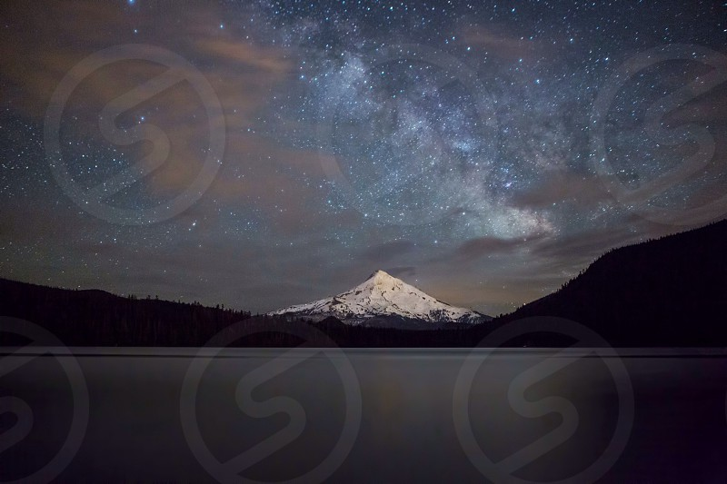 snowy mountain at night photo