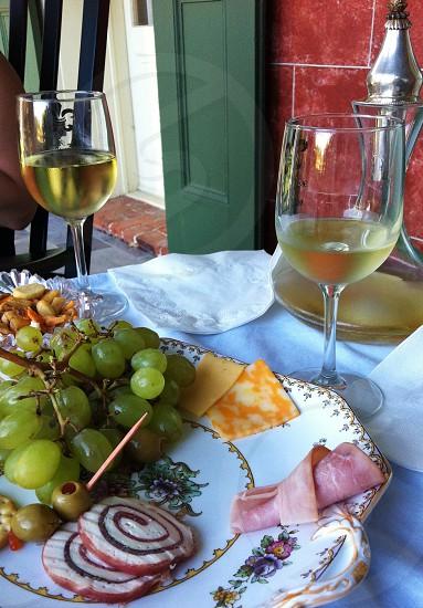 clear wine glass near white plate photo