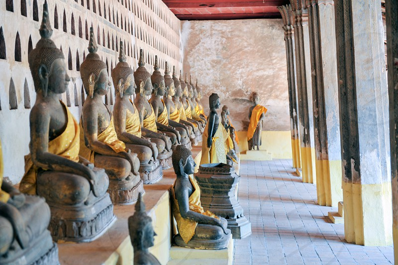 The cloister housing numerous Buddha images in Wat Si Saket most revered Buddhist temple in city of Vientiane capital of Lao PDR. photo