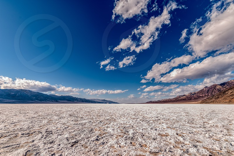 Badwater Basin in Death Valley National Park on a sunny day photo