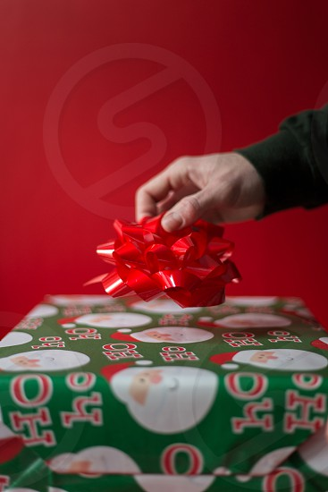Holiday Celebrations - candy canes and wrapping presents. photo