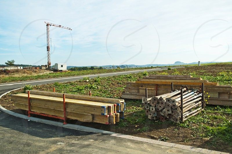 construction field with material and crane photo