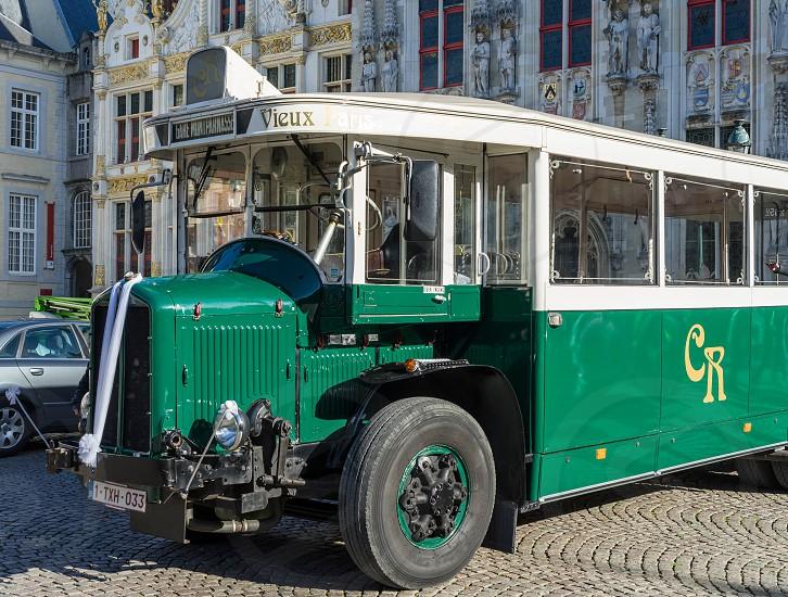 Old Bus in Market Square Bruges photo