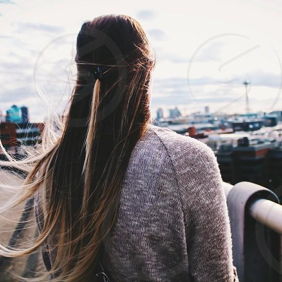 woman standing near the rail photo