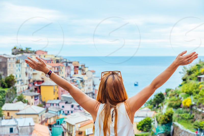 Young woman traveling through Europe Cinque Terre Italy photo