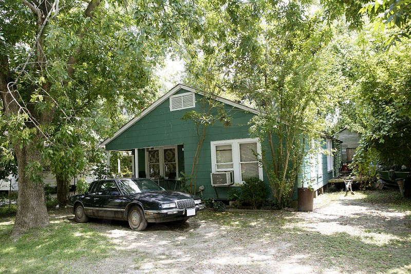 Country houses in Texas with trees in background photo