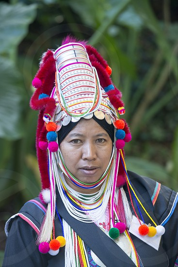 a Ahka hill Tribe women at the Mae Fah Luang ornamental garden at the village of  Doi Tung north of the city of Chiang Rai in North Thailand. photo