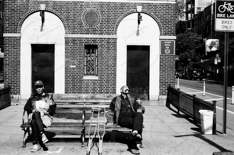 Lifestyle men on a bench sun newyork city crutches  photo